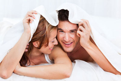 Couple Under Sheets