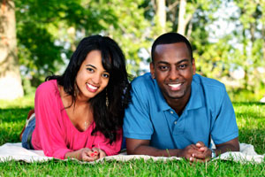 happy-interacial-couple-in-park